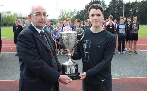 Army Cadet CSM Daniel Rowe receiving an Athletics Trophy