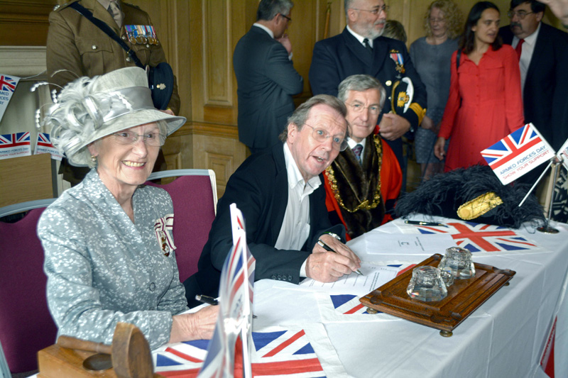 The Mayor of Bristol, George Ferguson, is first to sign the Covenant, watched by the Lord-Lieutenant, Mary Prior MBE, and the Lord Mayor, Cllr Alastair Watson (right).